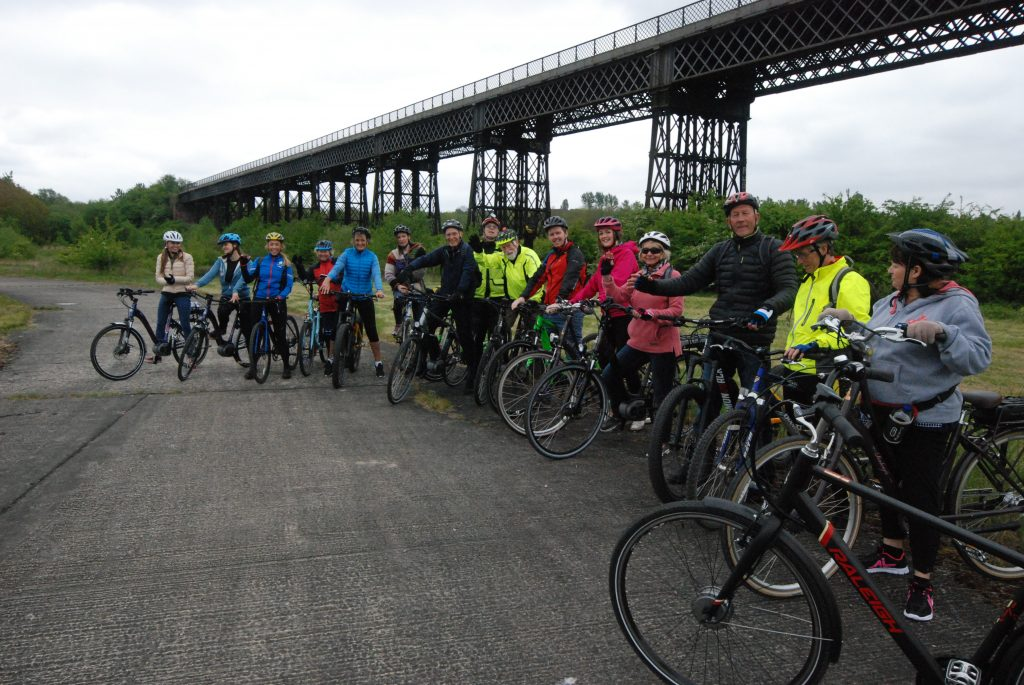 A group of cyclists assemble under the viaduct on a trip from the nearby Raleigh works in Eastwood