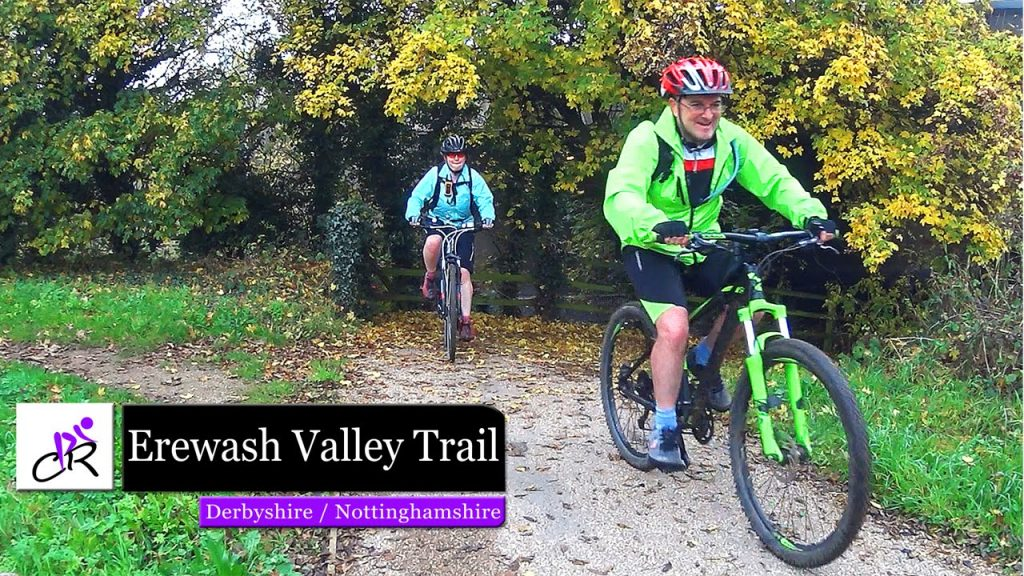 The image shows two cyclists riding on the Erewash valley Trail in the Autumn